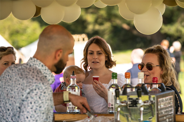 Wedding guests at a tipi bar