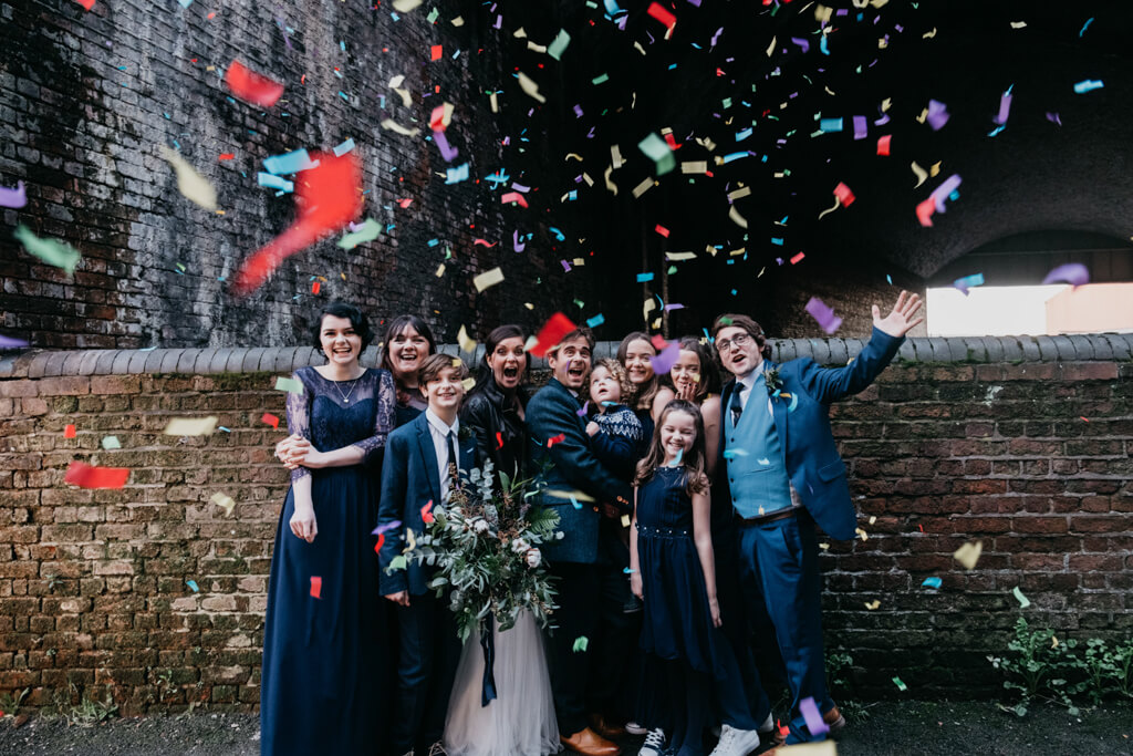 Wedding guests celebrate with confetti