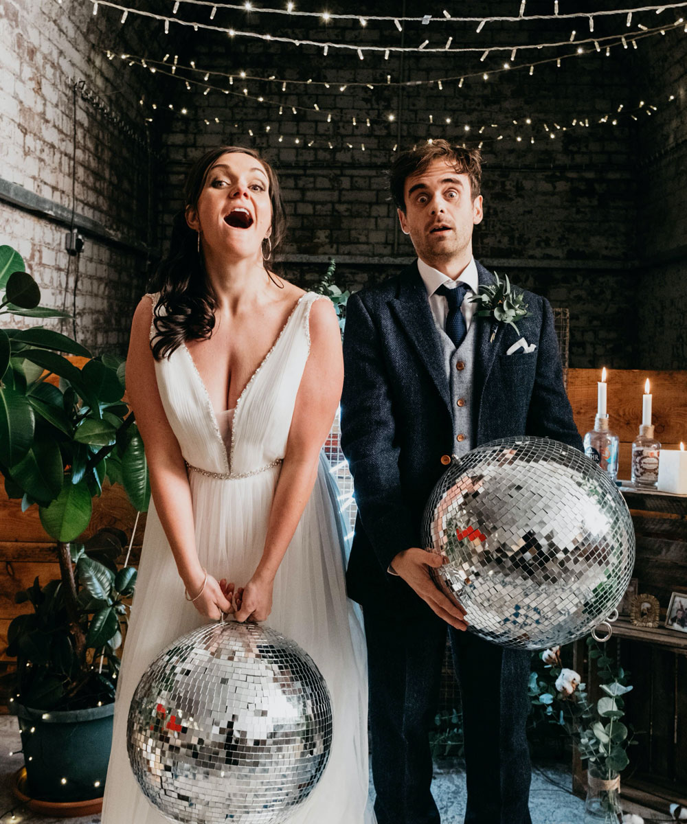 Bride & Groom with disco balls at their wedding