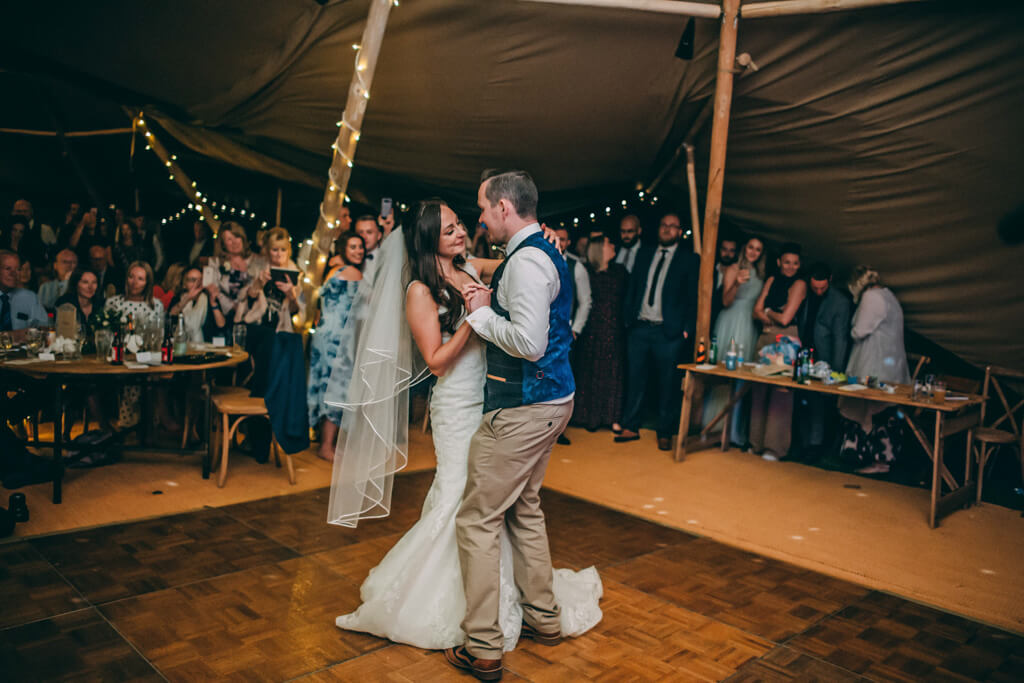 Bride & Groom first dance inside tipi wedding