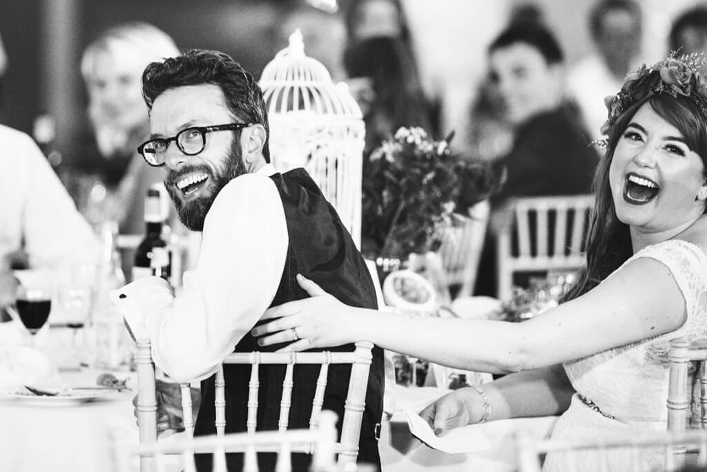 Bride & Groom reacting to speech at their wedding